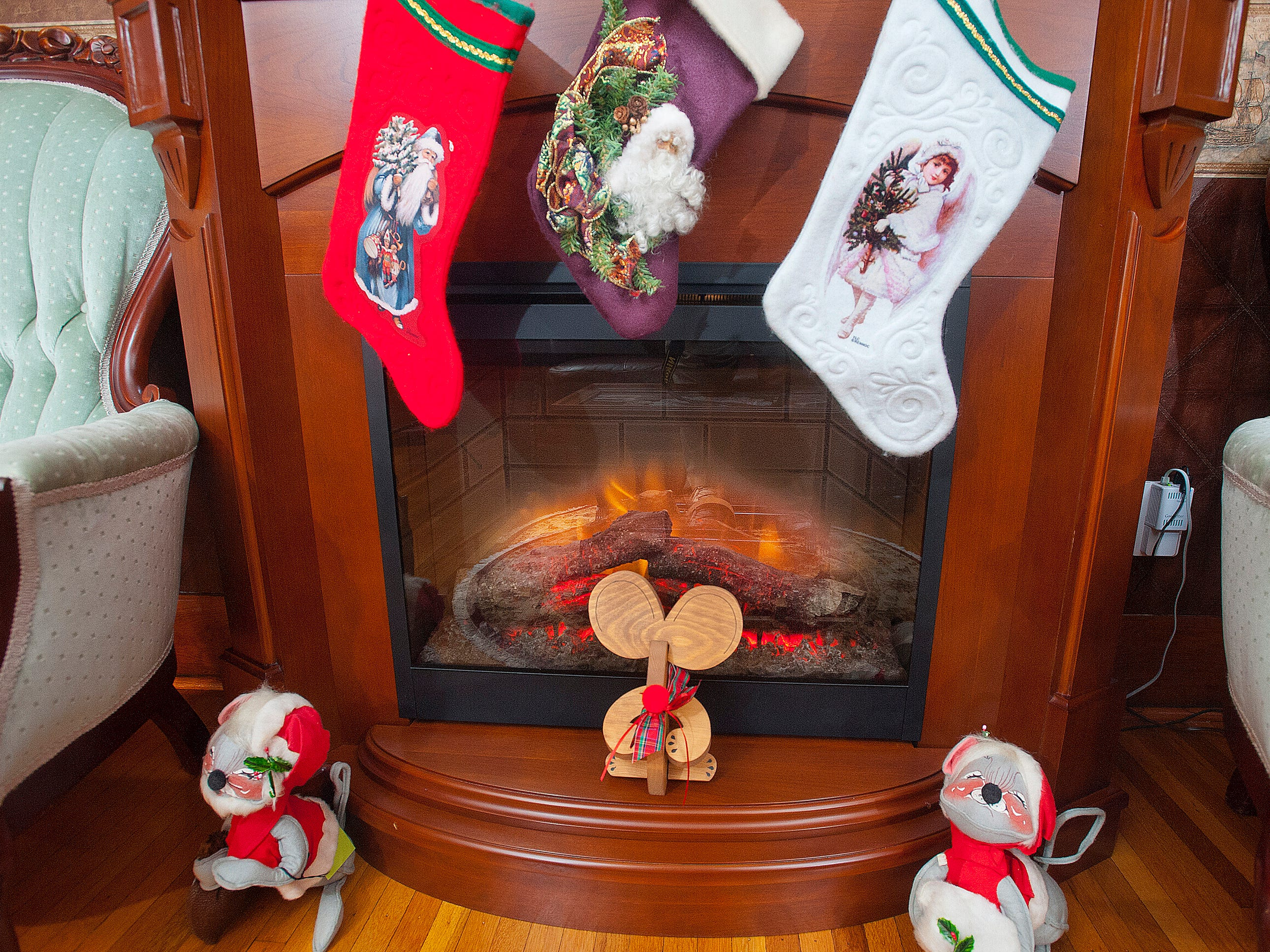 "Stockings are hung over the fireplace in the ""Santa Room,"" the name the Cliffords give their den during the Christmas holidays.