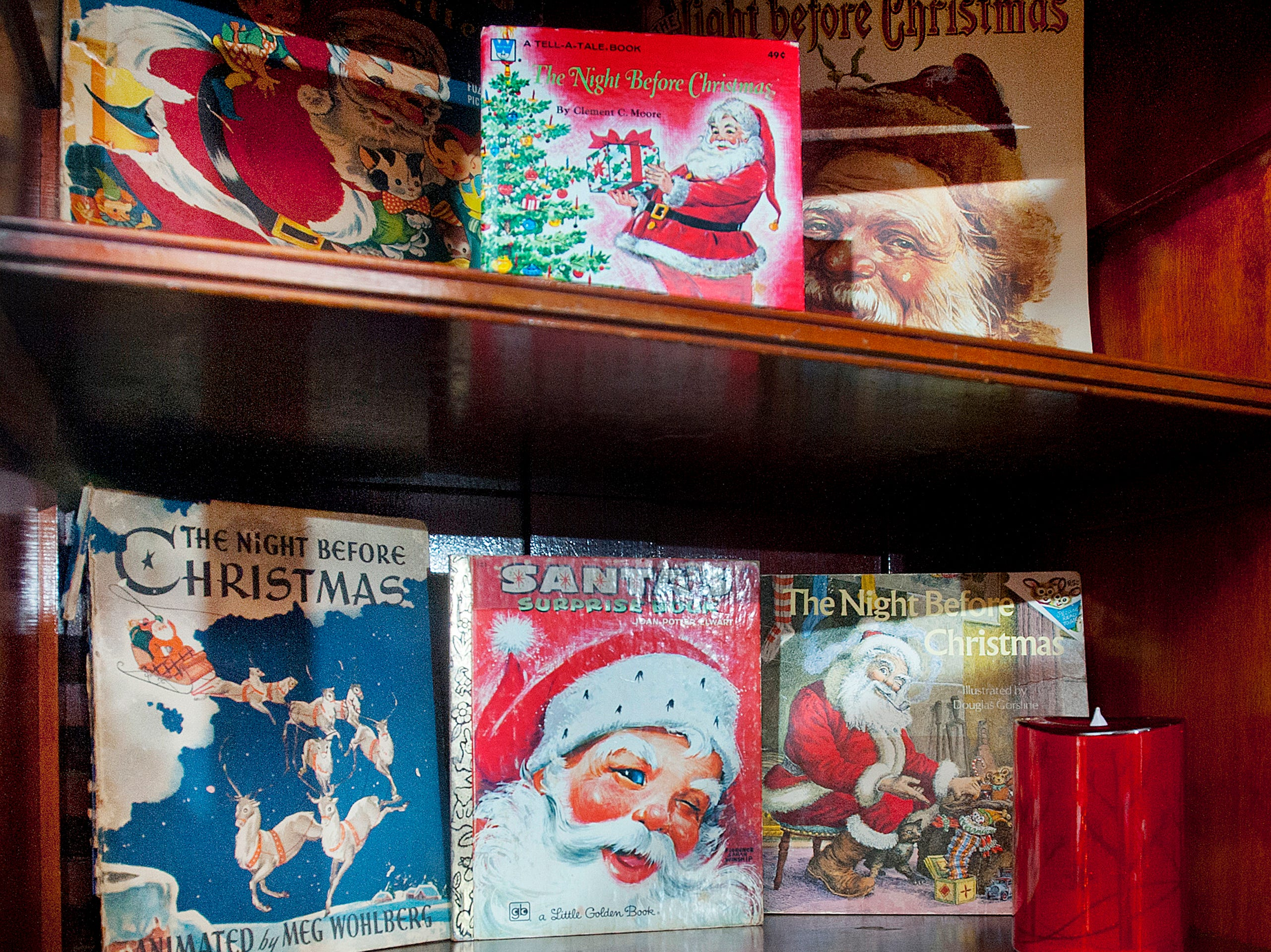 "The shelves of the ""Santa Room,"" are filled with Christmas and Santa story books.