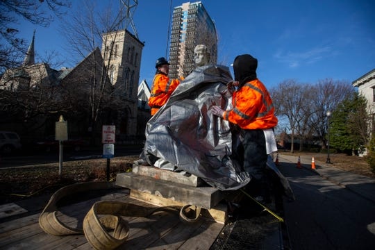 A contracting crew takes down the Prentice statue in downtown Louisville. Dec. 11, 2018