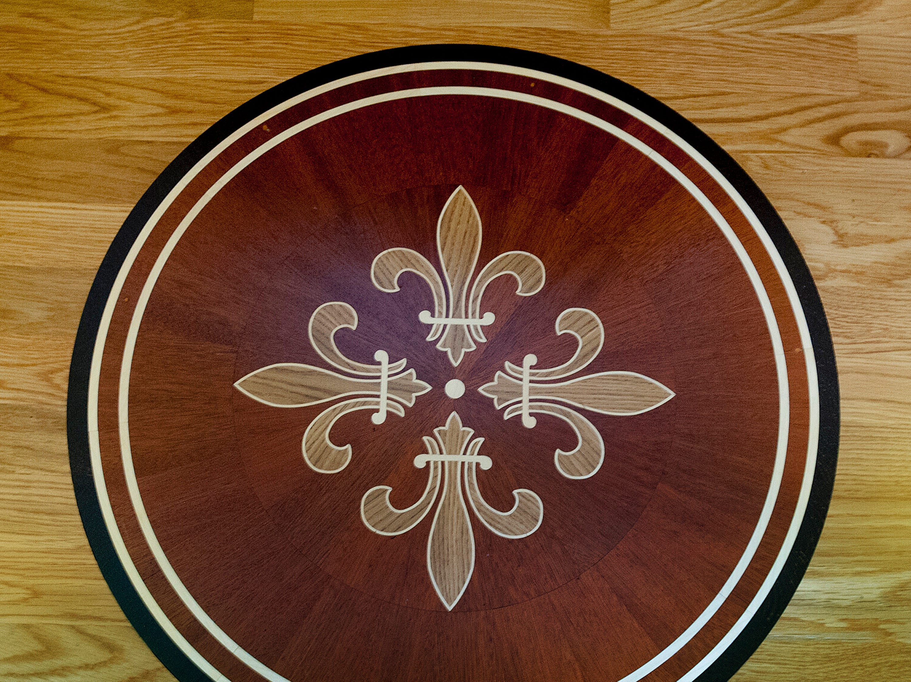 A Fleur de Lis inlay adorns the landing between the first and second floors of the Clifford's Portland home.