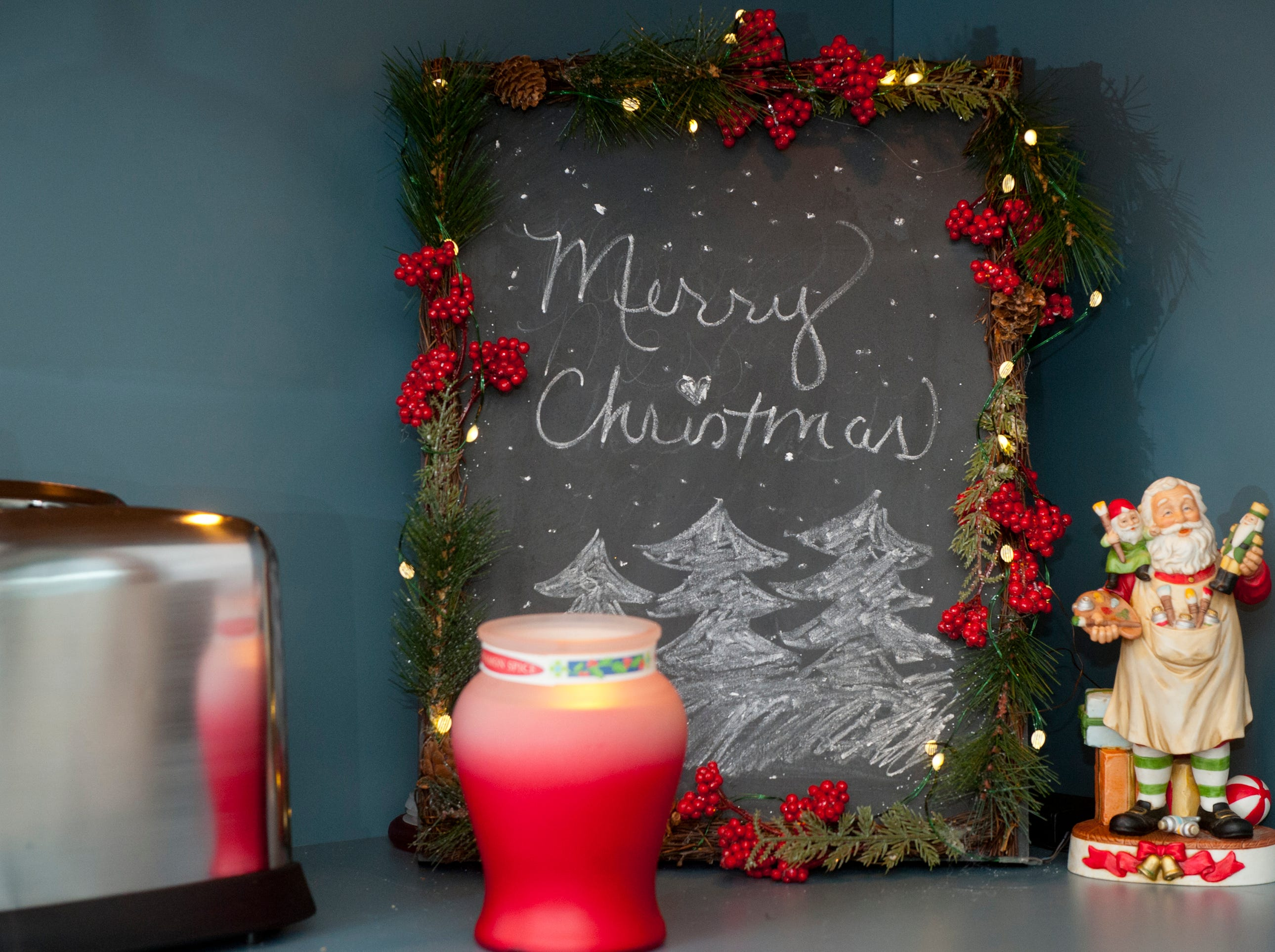 In the Clifford kitchen, a slate board wrapped in holly greets you with a holiday message.
