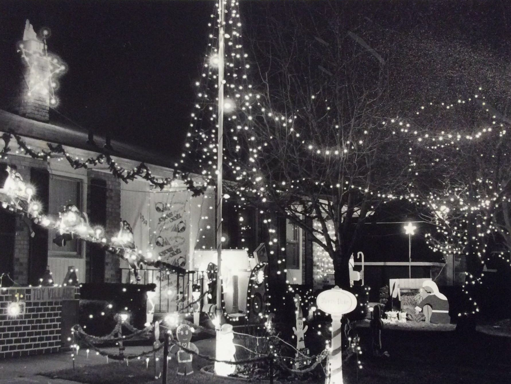Another view of the home of Bob and Marjorie Kletke, of 1319 Chester Road in Lansing. In addition to lighting up the house, they handed out candy canes and helped Santa collect and answer letters to the North Pole, December 1993.