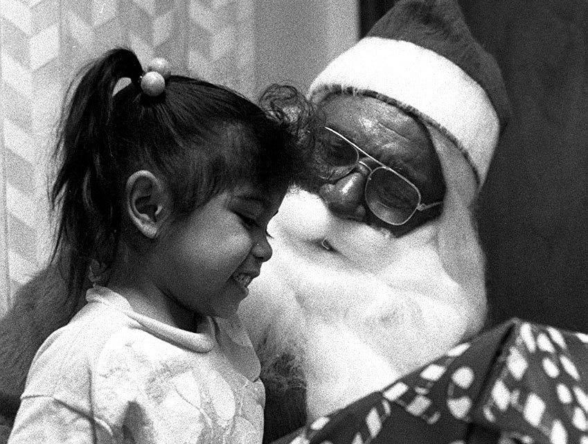Dick Letts plays Santa at Galilee Baptist Church, Dec. 17, 1992.