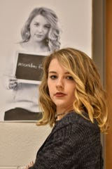 "Abigail Parry, a senior at Bath High School and a student leader on the ""The Chalkboard Project,"" has been called an ""insensitive f**k"""" as seen in her portrait that hangs in the hallways at Bath High School. She said she wanted to help with the project because a close friend had been bullied and called a ""whore"" and ""slut."""
