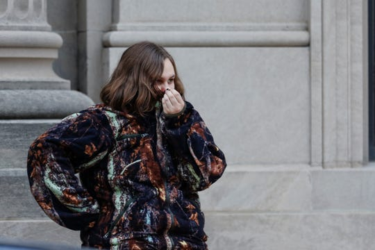 A girl covers her nose from the smell of gas as local authorities look for the source of a gas leak downtown near the Schuette building Tuesday, December 11, 2018, in Manitowoc, Wis. Joshua Clark/USA TODAY NETWORK-Wisconsin