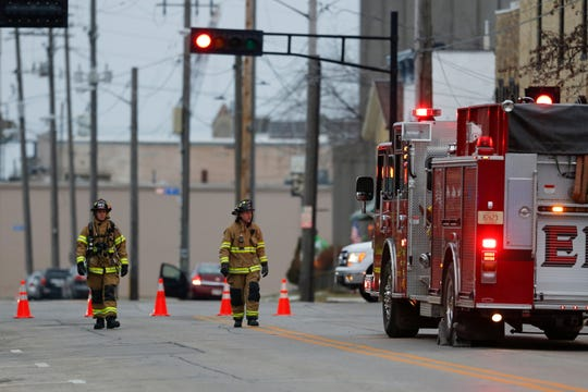 Firefighters walk west down Franklin Street near 8th Street as they evacuate local businesses in the area Tuesday, December 11, 2018, in Manitowoc, Wis. Joshua Clark/USA TODAY NETWORK-Wisconsin