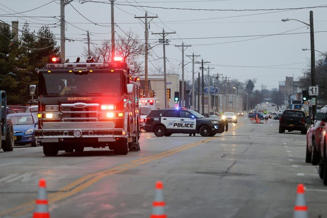 Local authorities block off streets near 8th and Franklin as they look for the source of a gas leak downtown near the Schuette building Tuesday, December 11, 2018, in Manitowoc, Wis. Joshua Clark/USA TODAY NETWORK-Wisconsin