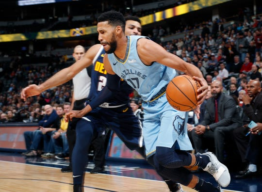 Memphis Grizzlies guard Garrett Temple, front, drives tot he rim past Denver Nuggets guard Jamal Murray in the first half of an NBA basketball game Monday, Dec. 10, 2018, in Denver. (AP Photo/David Zalubowski)
