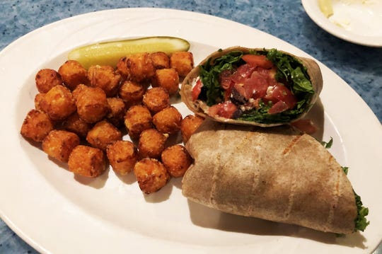 The salmon wrap with sweet potato puffs at CJ's On The Bay, Marco Island.