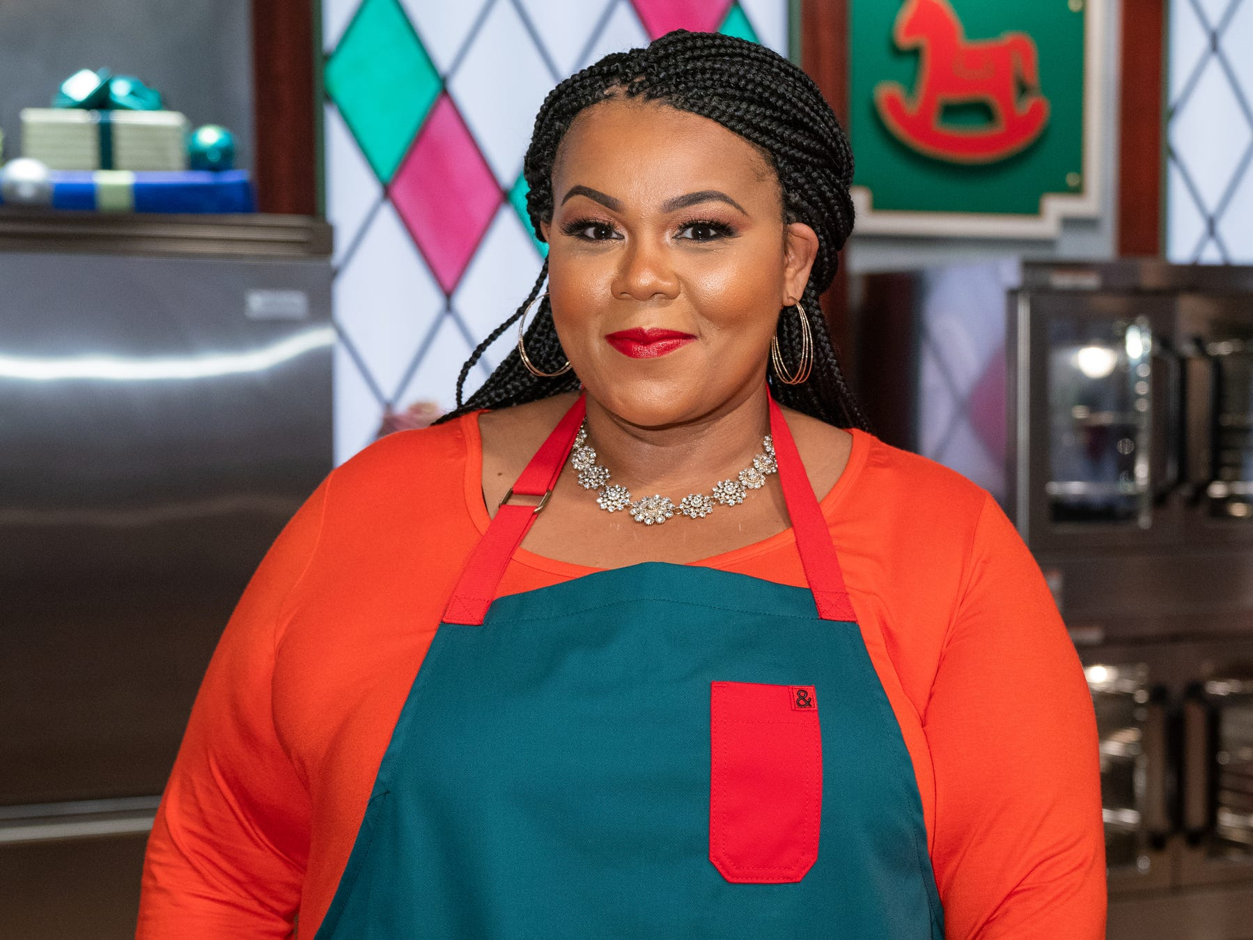 "Contestant Adija Smith during the first round of The Decorating Challenge, ""Christmas Nesting Doll Cookies,"" as seen on ""Christmas Cookie Challenge,"" Season 2, on the Food Network."
