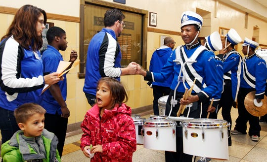 """Paul Braun, co-director of the North Division High School Drumline (left) shakes Maleak Taylor's hand, before the start of the MPS Hosts City Drumline Competition at Rufus King High School. """"Most freshmen come in and they act like freshmen. You don't see that from Maleak. He's a real leader and we (the drum line) will go as he goes. He's the leader,"""" said Braun."""