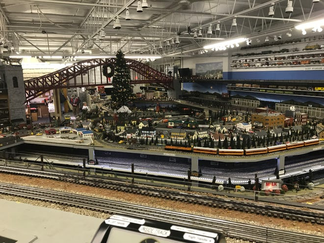 A Christmas tree stands as a centerpiece of the Milwaukee Lionel Railroad Club in New Berlin. Model train hobbyists, particularly those who grew up with Lionel O gauge trains, often think of trains and Christmas as one.