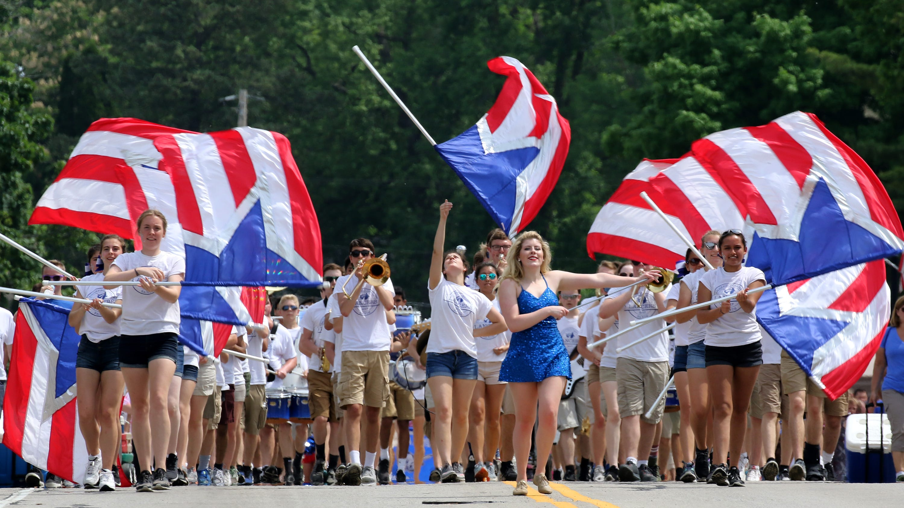 The Brookfield Central High School Marching Band performs along Watertown Plank Road during the 71st Elm Grove Memorial Day parade hosted by the Elm Grove Junior Guild and American Legion Post 449.