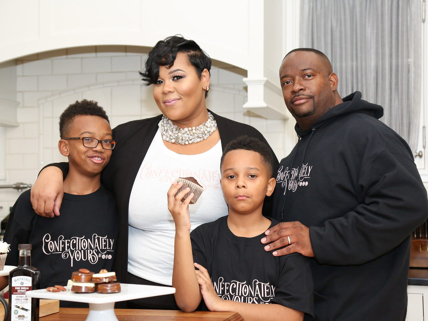 Adija's husband,  Emmitt L. Smith, who works with her at the bakery, and their sons, Xavier (left) and Malik.
