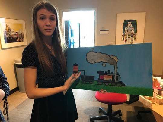 Kiersten Prom, a Menomonee Falls High School senior, shows a design for an educational display to teach kids how steam engines work. Students from several area high schools showed their designs for a new water tower for the Milwaukee County Zoo's steam trains to a panel of experts at MSOE Monday as part of an innovative technology education initiative.