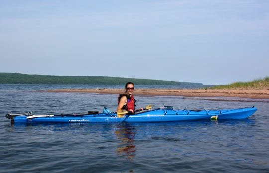 Milwaukee Journal Sentinel reporter Chelsey Lewis kayaks in Lake Superior near Oak Island in the Apostle Islands National Lakeshore.