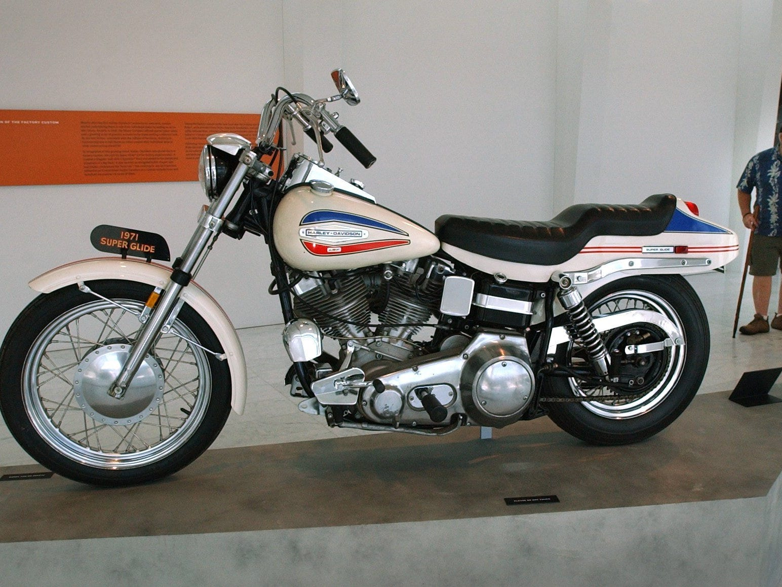 "A Harley-Davidson 1971 FX Super Glide is shown on display during ""Rolling Sculptures: The Art of Harley-Davidson,"" an exhibit at the Milwaukee Art Museum in 2003. The bike's gas tank includes the logo of the company's new owner, AMF, below the Harley logo."