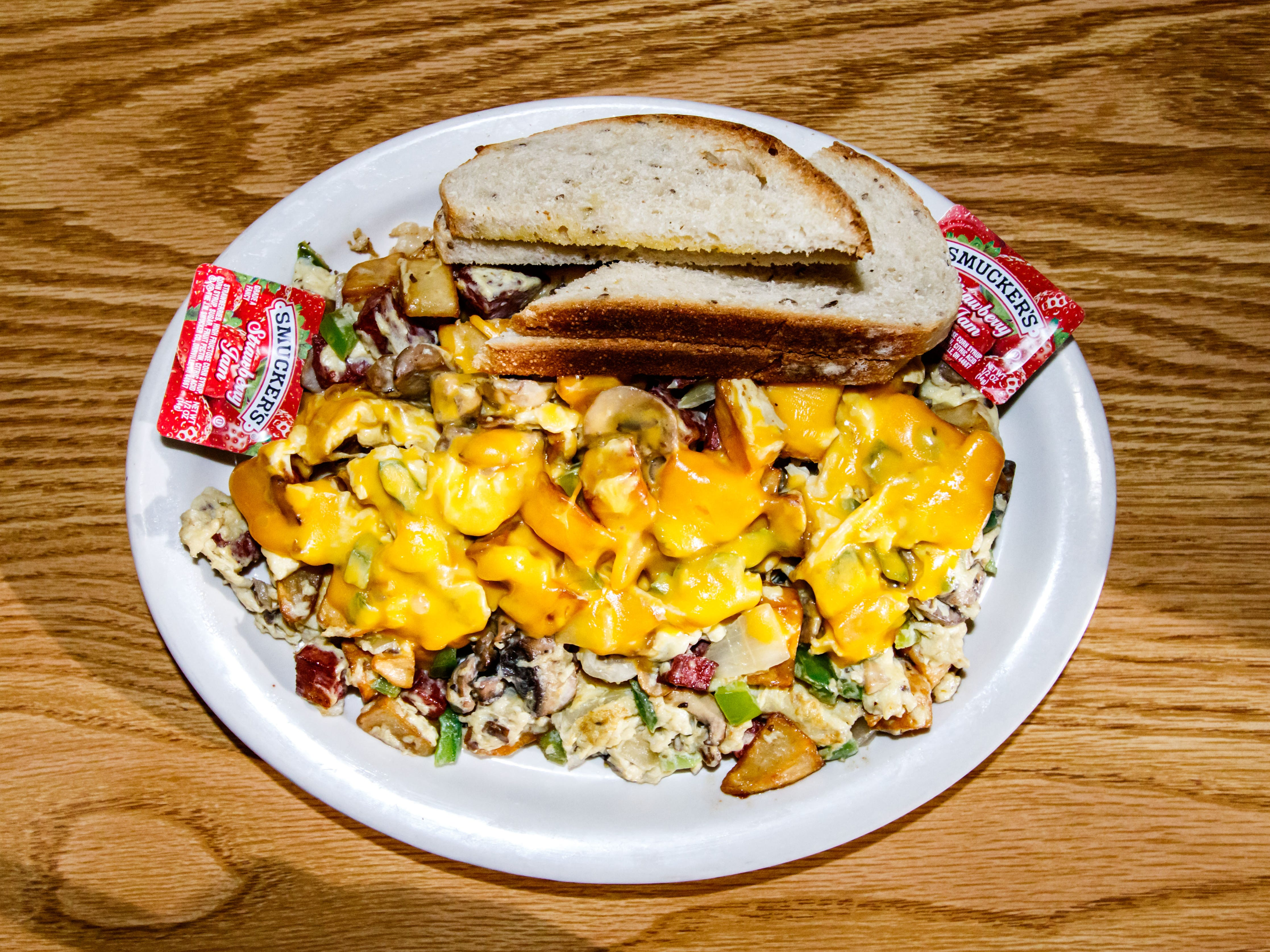 The Super Hoppel Poppel plate at Benji's Delicatessen in Shorewood features scrambled eggs blended with crisp browned potatoes, fried salami, green peppers, onions, fresh mushrooms and your choice of cheese.