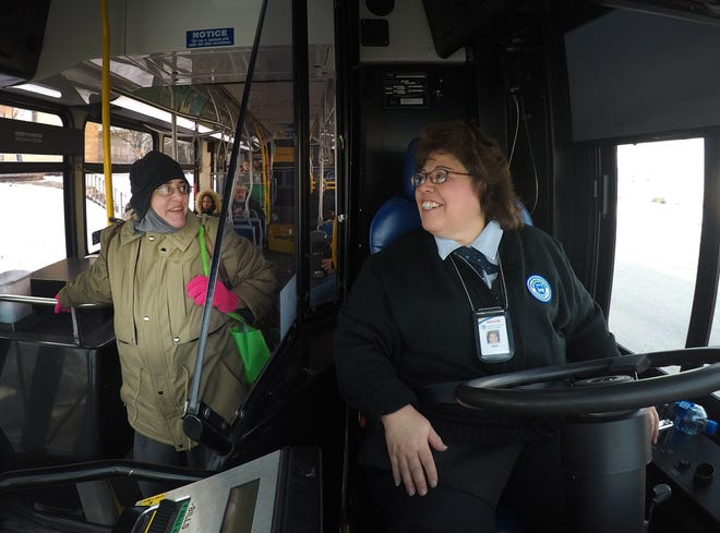 Bus driver Karen Martinez talks with passenger Jackie Franken as she gets near her stop on Milwaukee County Transit Service route 53 along Lincoln Ave. Wednesday, November 28, 2018 in Milwaukee.