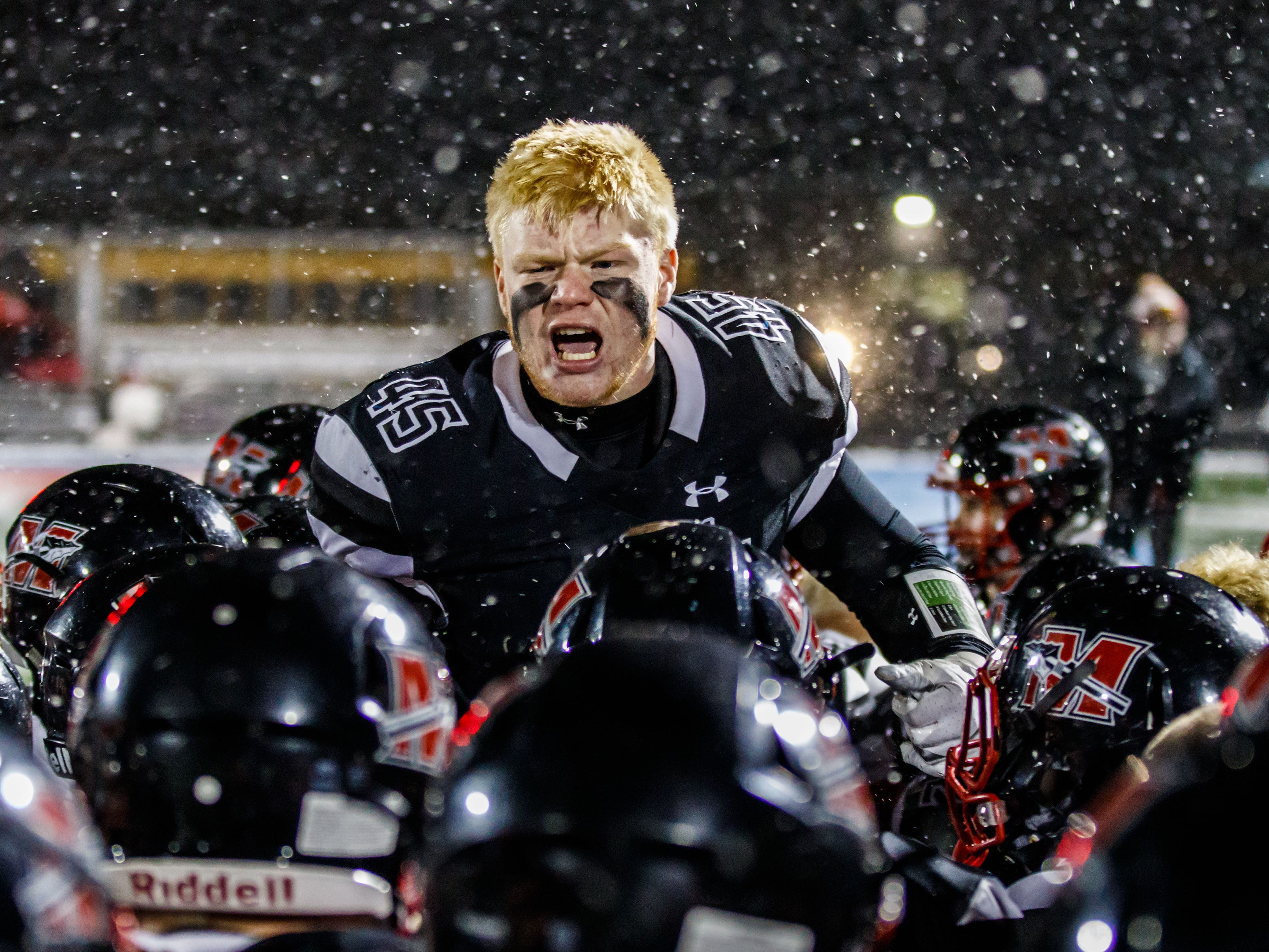 Muskego High School senior Mitch Borkovec fires up his team prior to the WIAA Division 1 playoff game against Marquette University High School in Hartland.