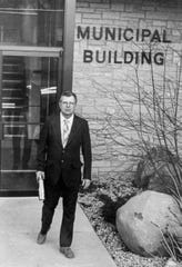 """The Hartland Village Board recently voted to rename its municipal building as """"The Richard Landwehr Municipal Building."""" This photo is of Landwehr in front of the municipal building while he served as village president in 1985."""