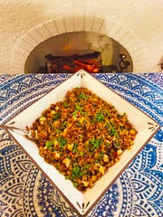 """Michael Litz's original recipe is for a vegetarian fried rice, but it also can be made with cauliflower """"rice"""" to make it paleo."""