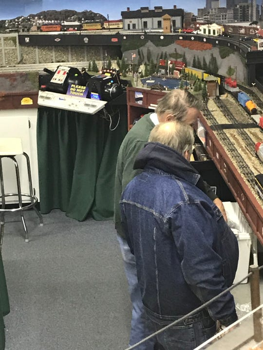 Milwaukee Lionel Railroad Club members Bill Hitchcock (rear) and John Krokowski pack away their trains for the evening after one recent Friday night season in December. The club has just over 200 active members and a 3,000-square-foot clubhouse in New Berlin.