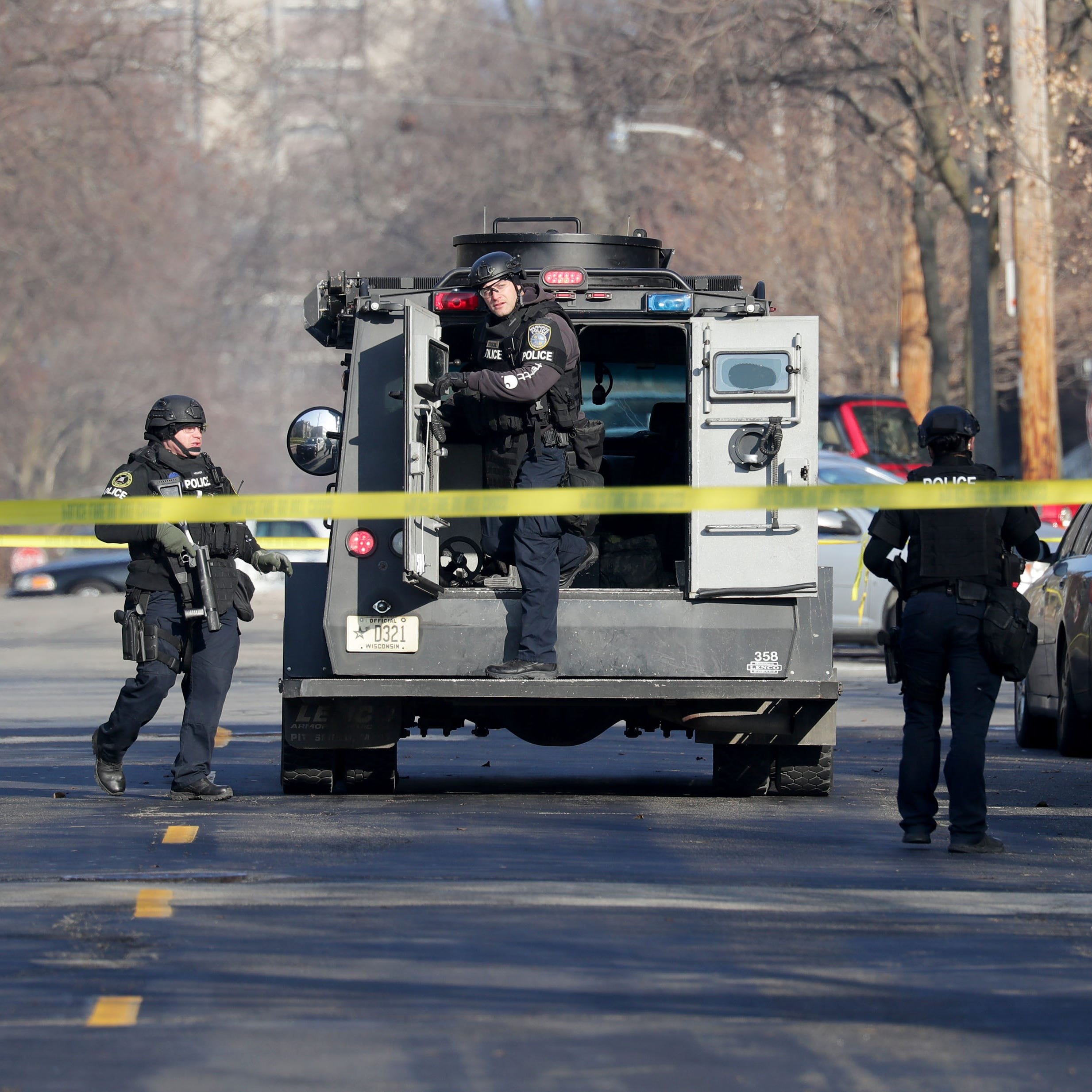 Man who threatened to shoot officers is arrested after standoff on Milwaukee's east side