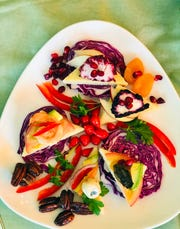 Vegan pizza triangles can be artfully arranged on a platter with veggies, fruits and nuts, foods allowed on many diets.