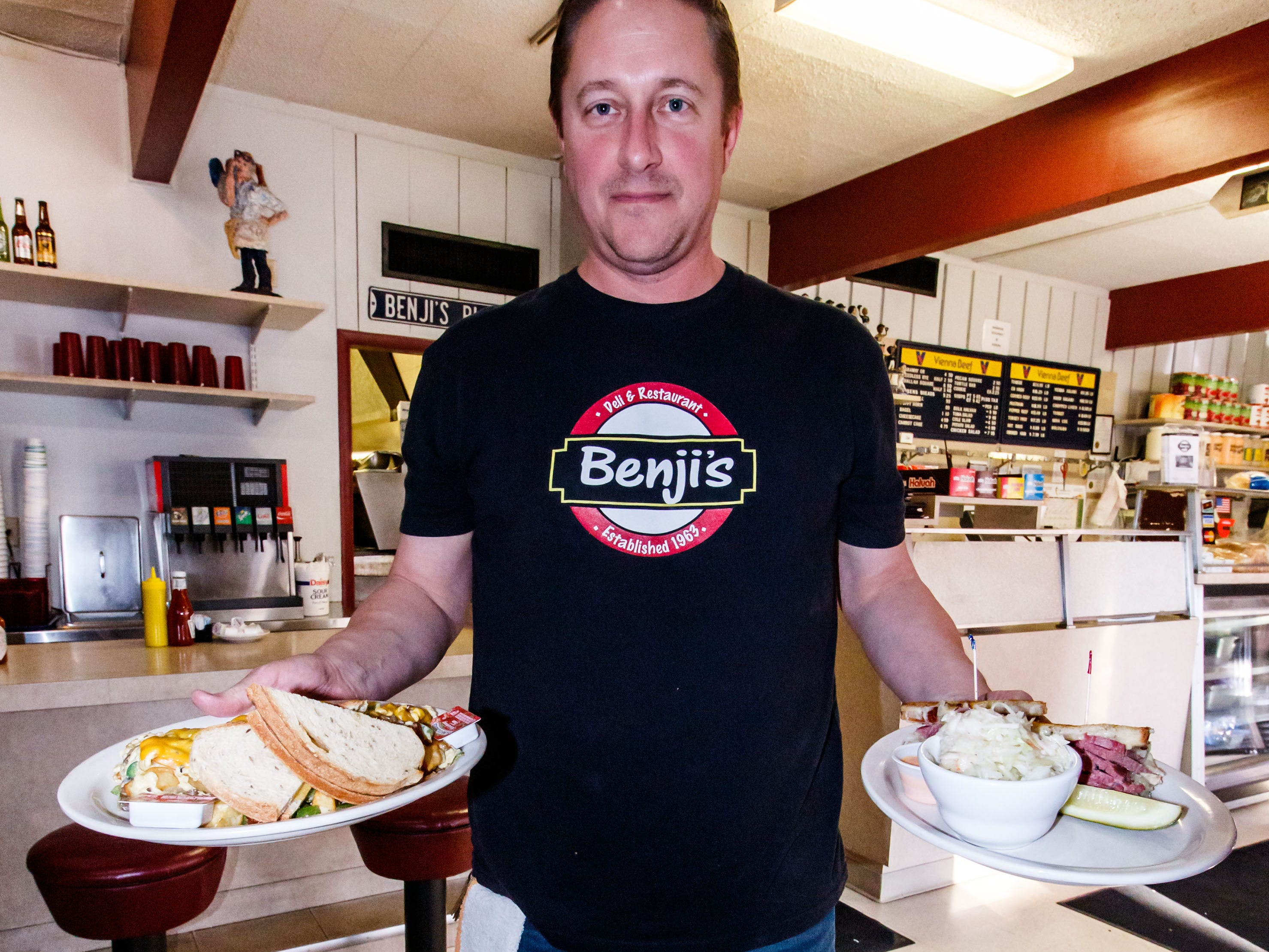 Owner Mike Price of Benji's Delicatessen in Shorewood serves up the Super Hoppel Poppel breakfast special and a Classic Reuben sandwich on Monday, Dec. 10, 2018.