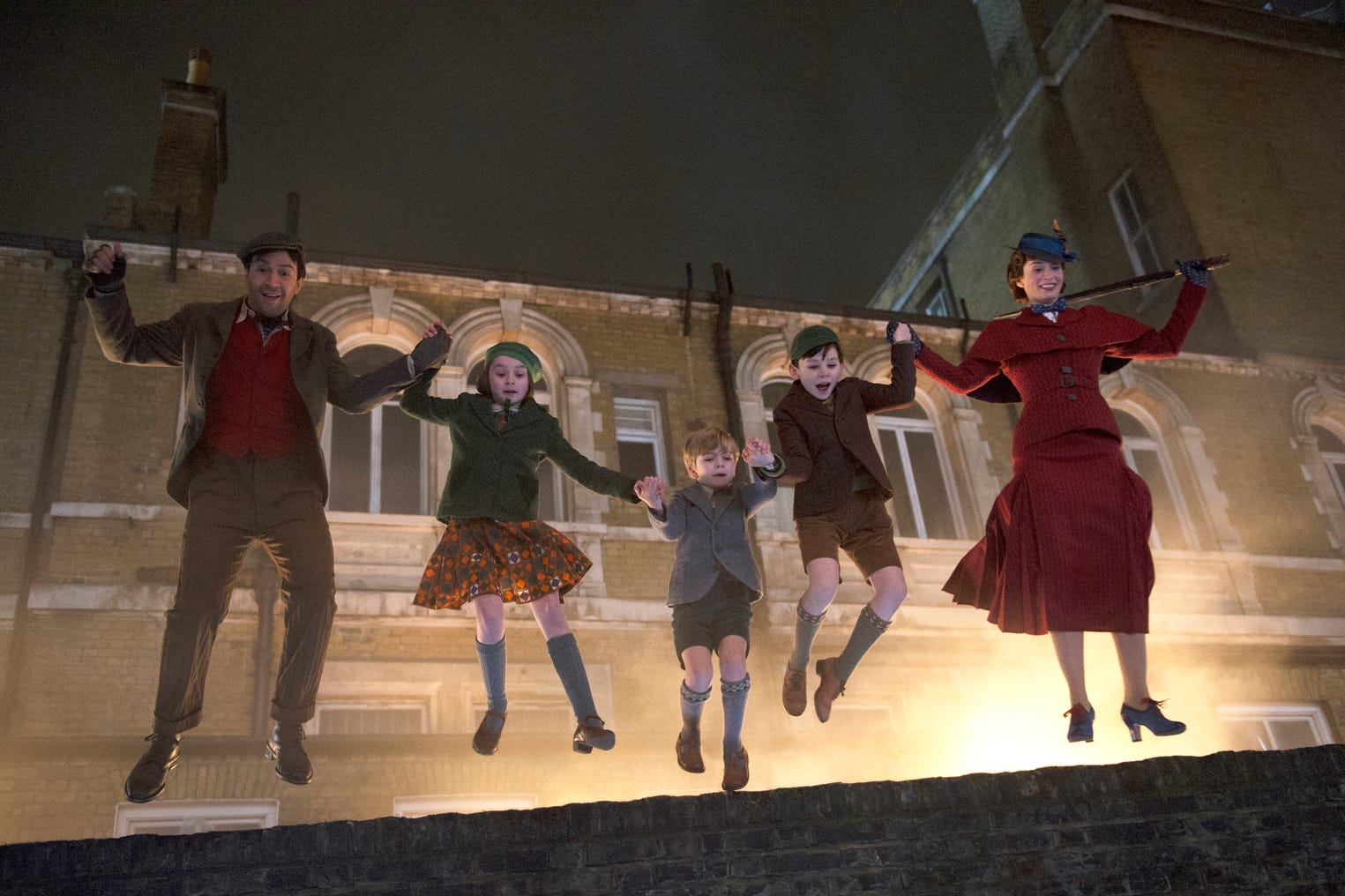 "Mary Poppins (Emily Blunt, right) leads another adventure, with (from left) Lin-Manuel Miranda, Pixie Davies, Joel Dawson and Nathanael Saleh in ""Mary Poppins Returns."""