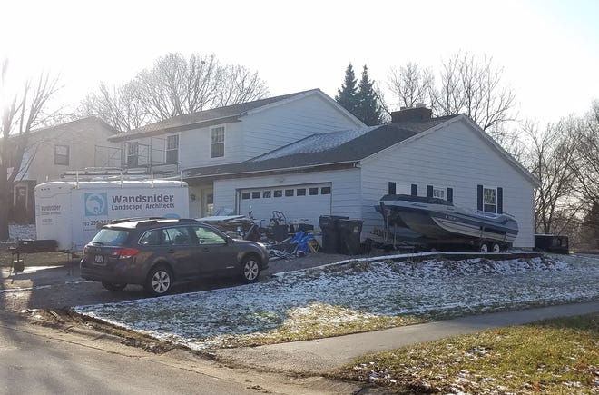 The village of Hartland is filing a lawsuit against the property owner at 709 Cardiff Court for various property violations, including multiple items being stored outside.