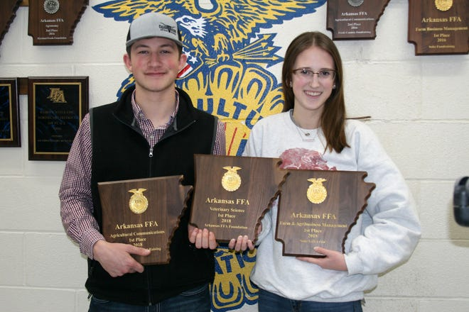 Members of the Mountain Home High School Chapter of the Future Farmers of America (FFA) have been busy the latter part of the semester participating in a number of career development events (CDEs) and attending both the Arkansas State Fair and FFA National Convention in Indianapolis. Pictured with their national convention plaques are Secretary of the MHHS FFA Dominic PIzzimenti, a junior, and President, senior Kelsey Rohr.