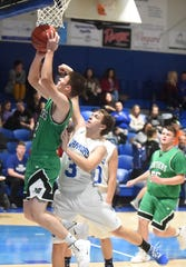 Yellville-Summit's Ben Riddle goes up for two of his game-high 34 points as Cotter's Tucker Coots defends on Monday night at Cotter.