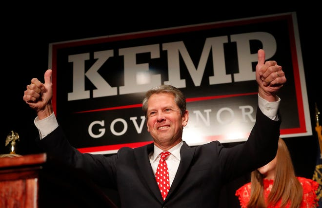 "FILE - In a Nov. 7, 2018 file photo, Georgia Republican gubernatorial candidate Brian Kemp gives a thumbs-up to supporters, in Athens, Ga. A political organization backed by Democrat Stacey Abrams filed a federal lawsuit Tuesday, Nov. 27, 2018 challenging the way Georgia's elections are run, making good on a promise Abrams made as she ended her bid to become the state's governor. As secretary of state, Abrams' opponent, Republican Gov.-elect Brian Kemp, was the top elections official until he declared himself the winner and resigned two days after the election. Abrams' campaign manager who's now CEO of Fair Fight Action, Lauren Groh-Wargo, said the campaign believed Kemp ""mismanaged this election to sway it in his favor.""   (AP Photo/John Bazemore, File)"