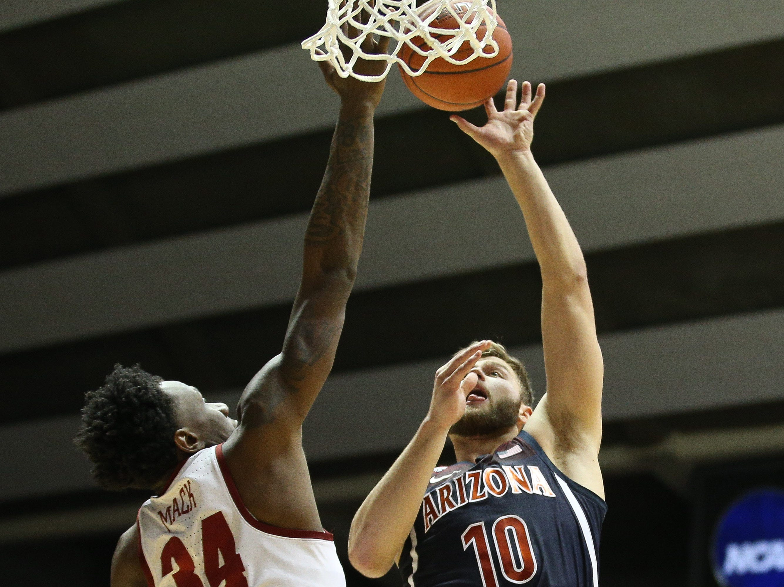 Dec 9, 2018; Tuscaloosa, AL, USA; Arizona Wildcats forward Ryan Luther (10) shoots over Alabama Crimson Tide guard Tevin Mack (34) during the first half at Coleman Coliseum. Mandatory Credit: Marvin Gentry-USA TODAY Sports