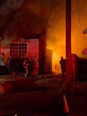 Firefighters at the scene of a house fire in the 600 block of North Maryland Street.