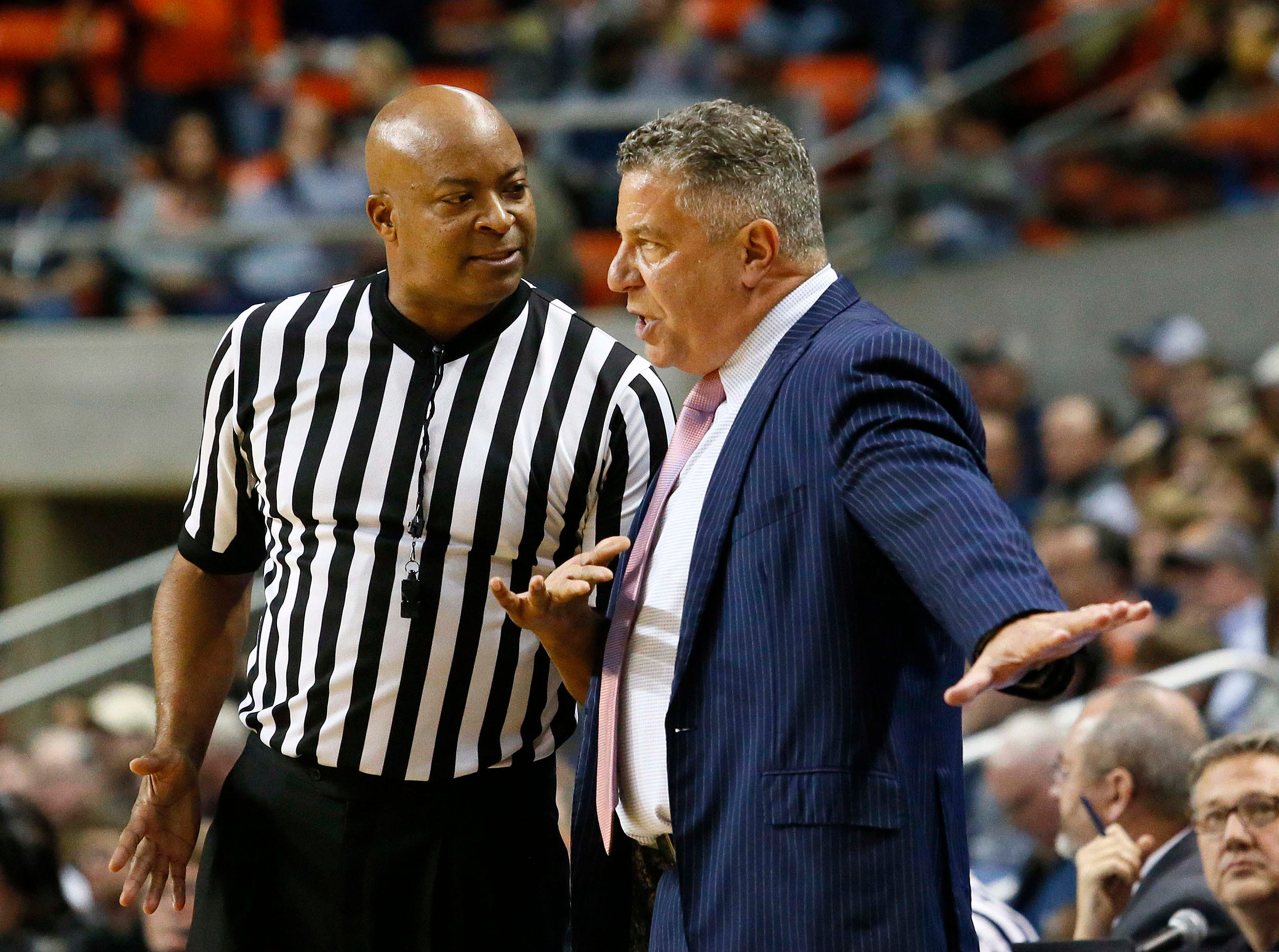 Dec 8, 2018; Auburn, AL, USA; Auburn Tigers head coach Bruce Pearl talks with an official during the first half against the Dayton Flyers at Auburn Arena. Mandatory Credit: John Reed-USA TODAY Sports