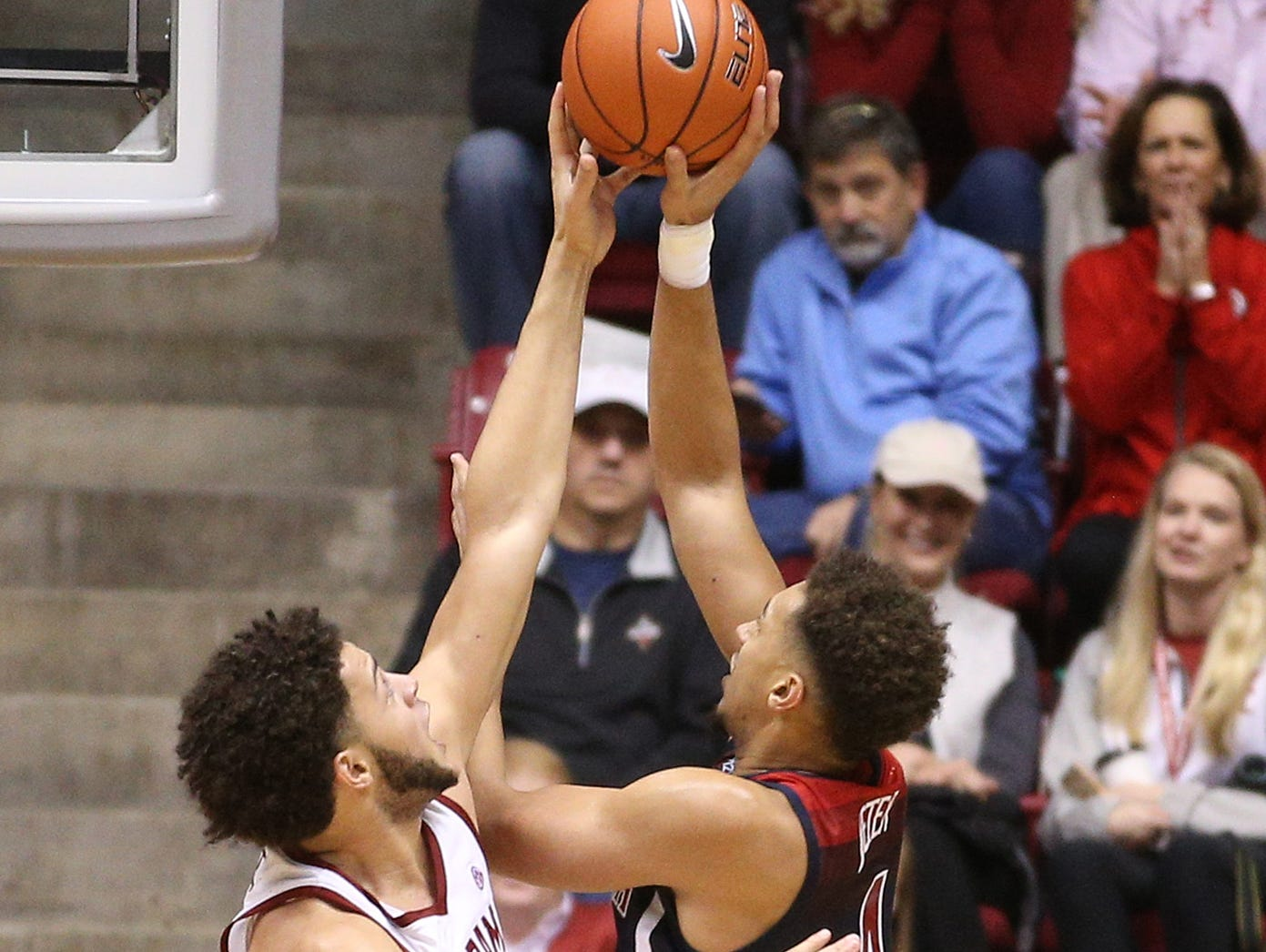 Dec 9, 2018; Tuscaloosa, AL, USA; Alabama Crimson Tide forward Alex Reese (3) blocks a shot by Arizona Wildcats center Chase Jeter (4) during the second half at Coleman Coliseum. Mandatory Credit: Marvin Gentry-USA TODAY Sports