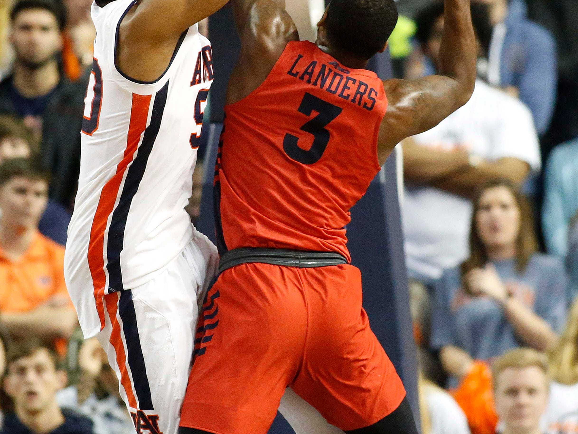 Dec 8, 2018; Auburn, AL, USA; Auburn Tigers center Austin Wiley (50) goes to block the shot from Dayton Flyers guard Trey Landers (3) during the second half at Auburn Arena. Mandatory Credit: John Reed-USA TODAY Sports