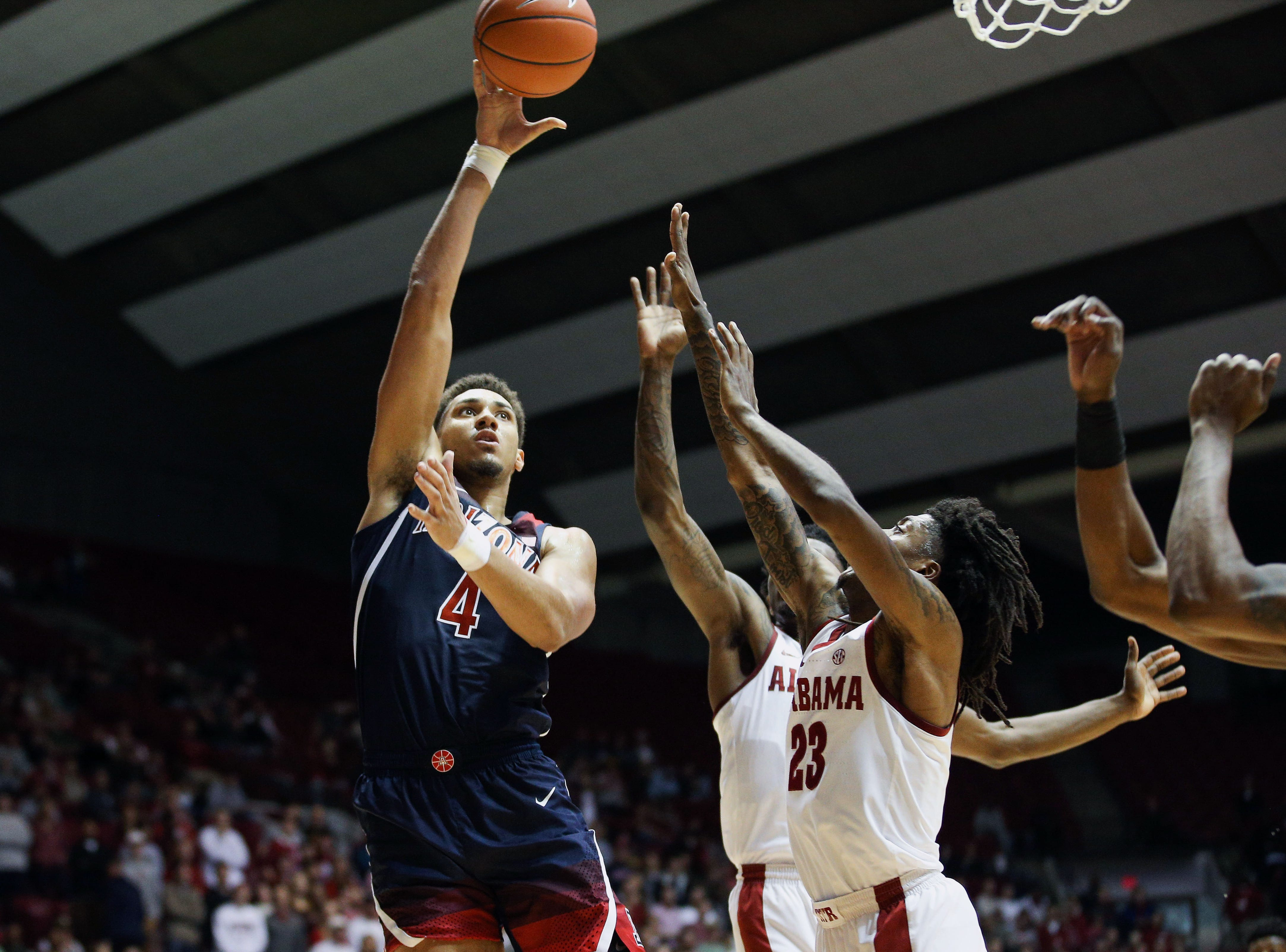 Dec 9, 2018; Tuscaloosa, AL, USA; Arizona Wildcats center Chase Jeter (4) shoots over Alabama Crimson Tide guard John Petty (23) during the first half at Coleman Coliseum. Mandatory Credit: Marvin Gentry-USA TODAY Sports