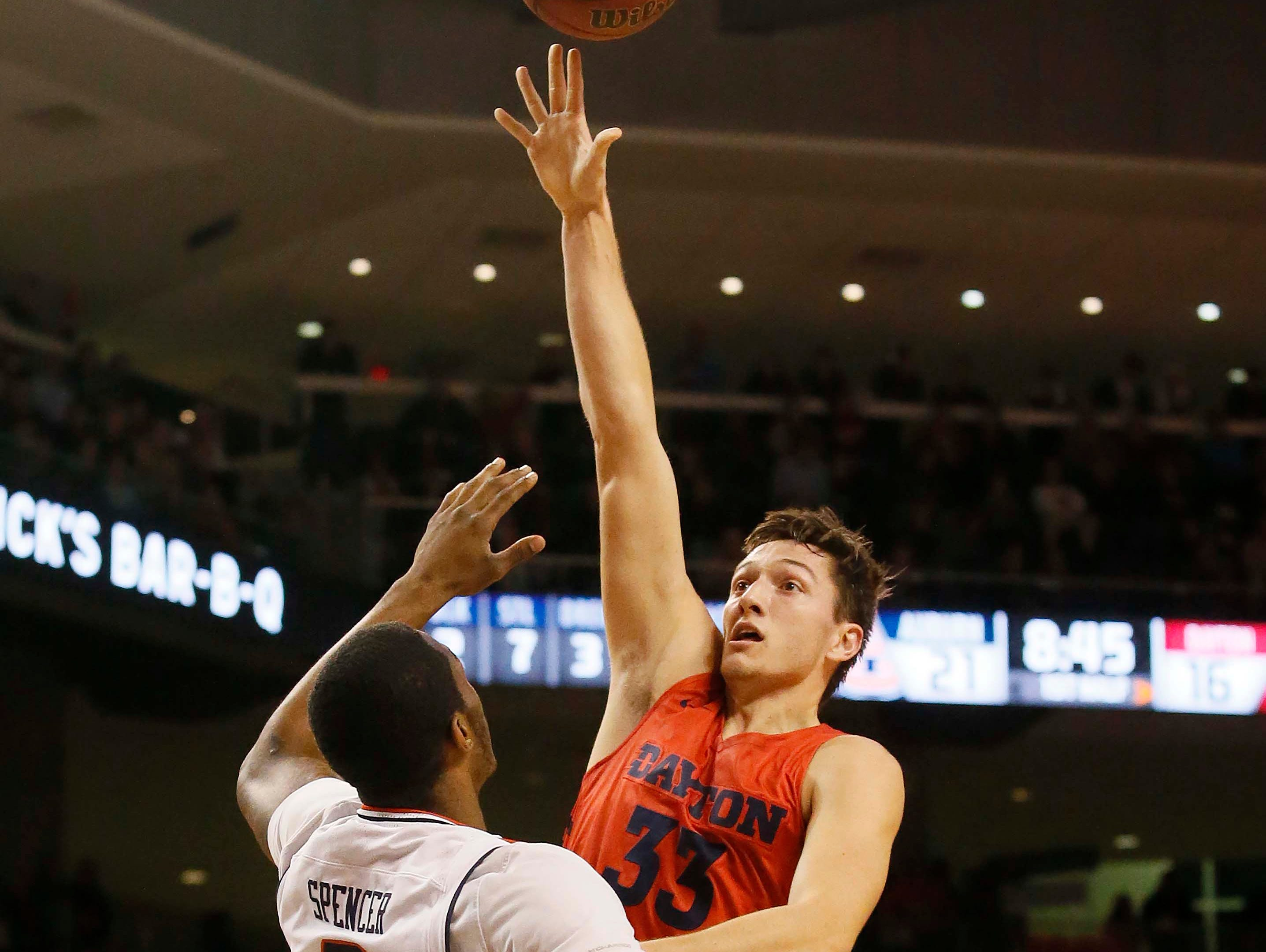 Dec 8, 2018; Auburn, AL, USA;  Dayton Flyers forward Ryan Mikesell (33) takes a shot over Auburn Tigers forward Horace Spencer (0) during the first half at Auburn Arena. Mandatory Credit: John Reed-USA TODAY Sports