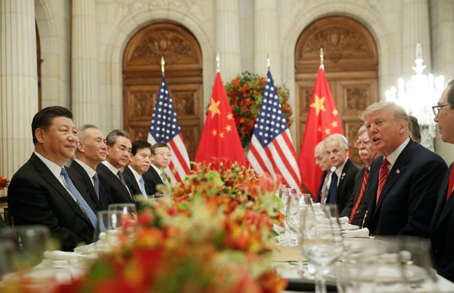 President Donald Trump, right, with China's President Xi Jinping, left, during their bilateral meeting at the G20 Summit, Saturday, Dec. 1, 2018 in Buenos Aires, Argentina. (AP Photo/Pablo Martinez Monsivais)
