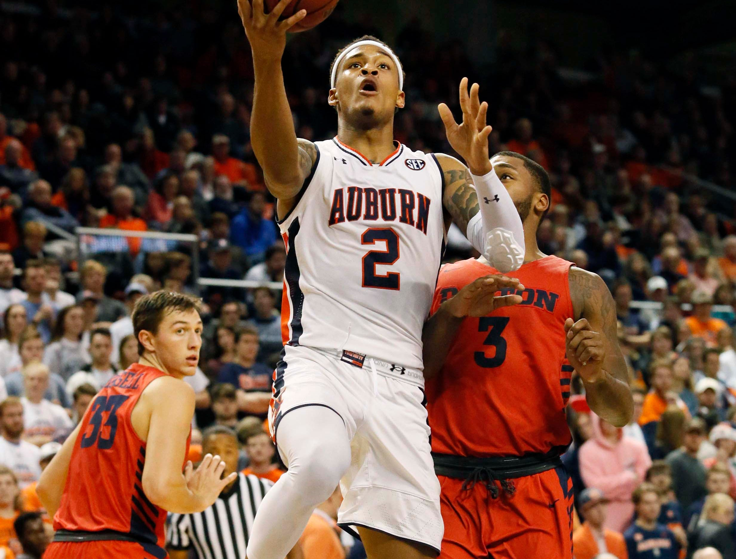 Dec 8, 2018; Auburn, AL, USA; Auburn Tigers guard Bryce Brown (2) takes a shot over Dayton Flyers Trey Landers (3) during the second half at Auburn Arena. Mandatory Credit: John Reed-USA TODAY Sports