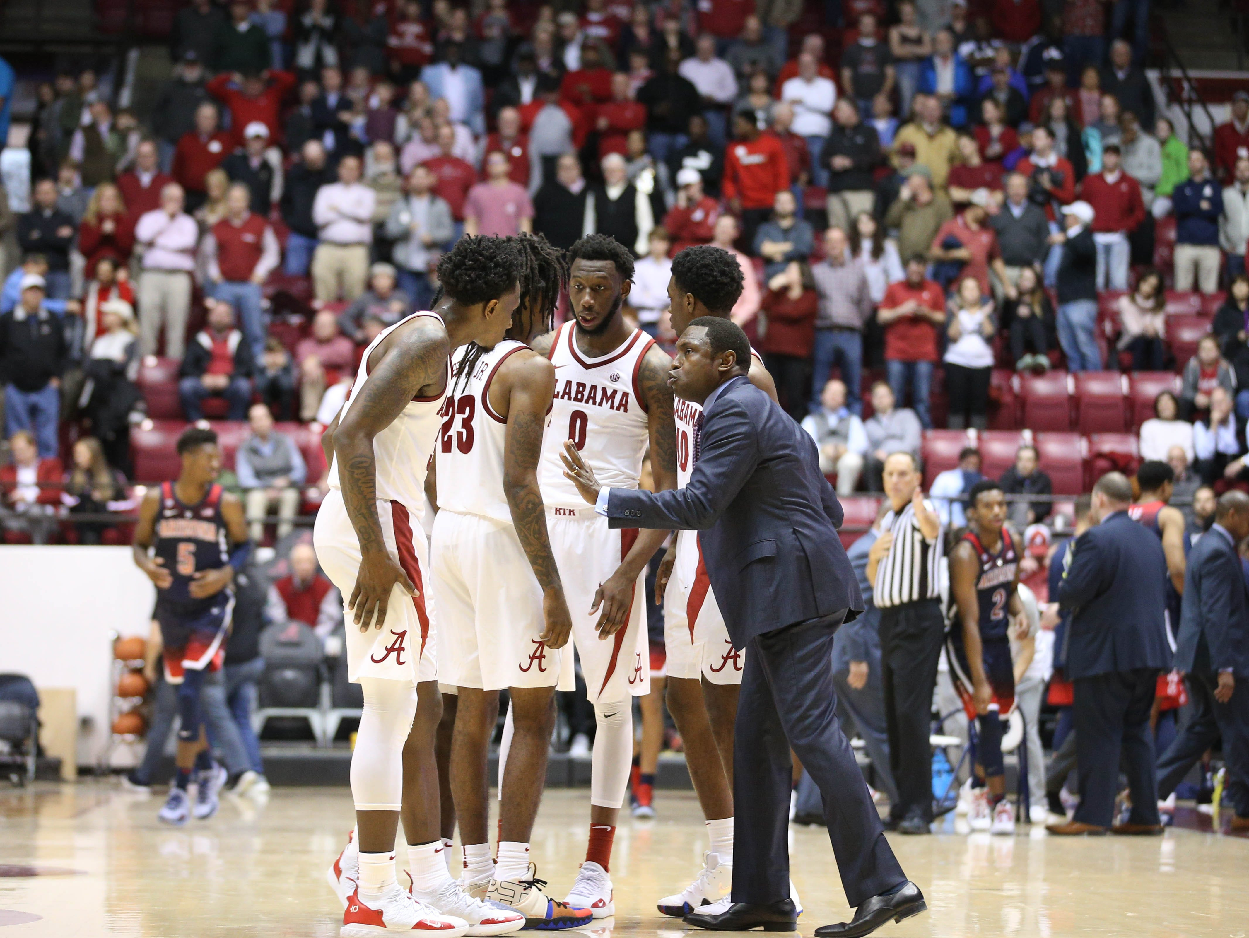 Dec 9, 2018; Tuscaloosa, AL, USA; Alabama Crimson Tide head coach Avery Johnson talks to his team during a timeout during the second half against the Arizona Wildcats at Coleman Coliseum. Mandatory Credit: Marvin Gentry-USA TODAY Sports