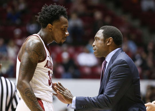 Dec 9, 2018; Tuscaloosa, AL, USA; Alabama Crimson Tide head coach Avery Johnson (right) talks to guard Tevin Mack (left) during the second half against the Arizona Wildcats at Coleman Coliseum. Mandatory Credit: Marvin Gentry-USA TODAY Sports