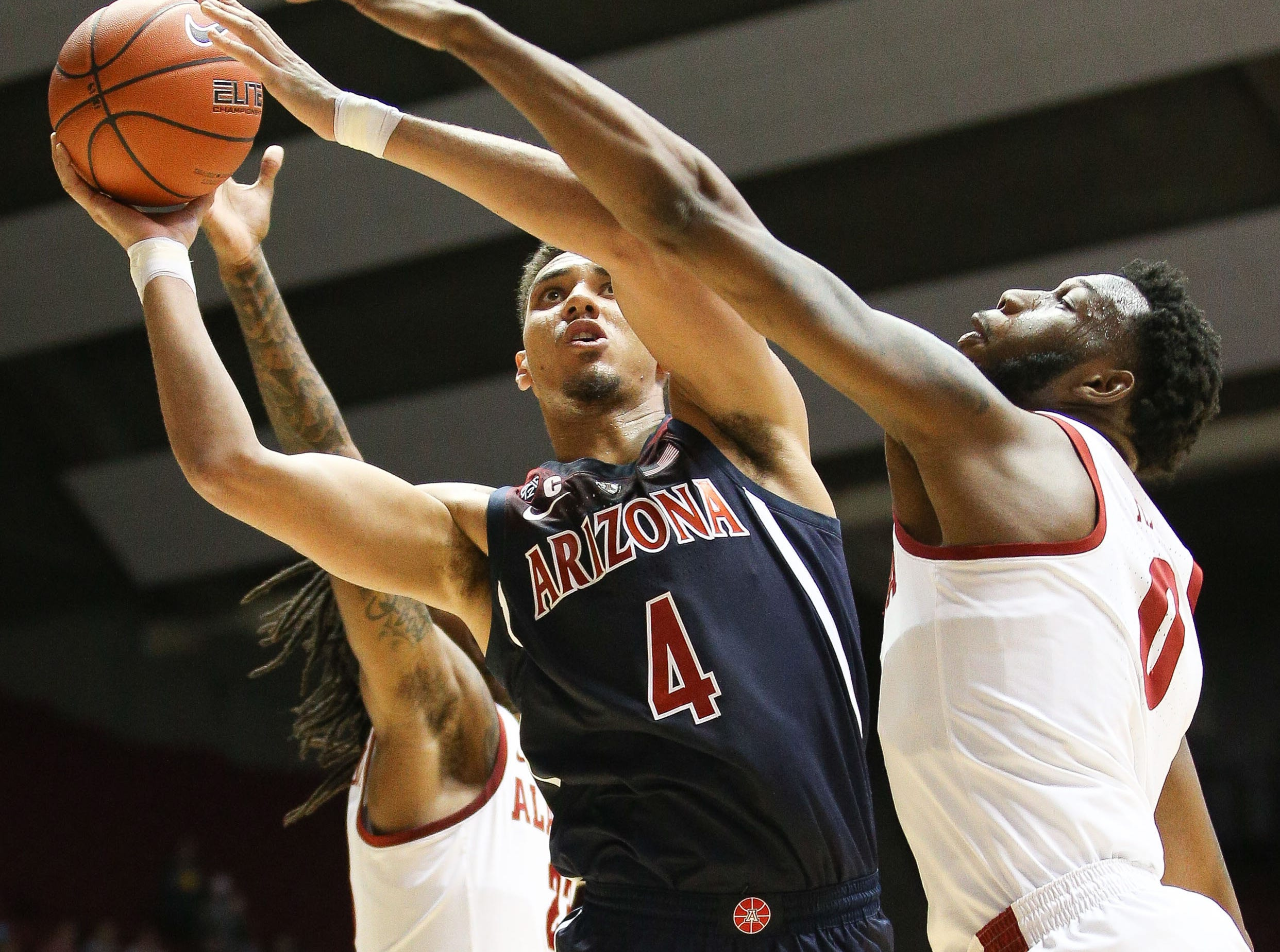 Dec 9, 2018; Tuscaloosa, AL, USA; Arizona Wildcats center Chase Jeter (4) shoots against Alabama Crimson Tide forward Donta Hall (0) during the first half at Coleman Coliseum. Mandatory Credit: Marvin Gentry-USA TODAY Sports