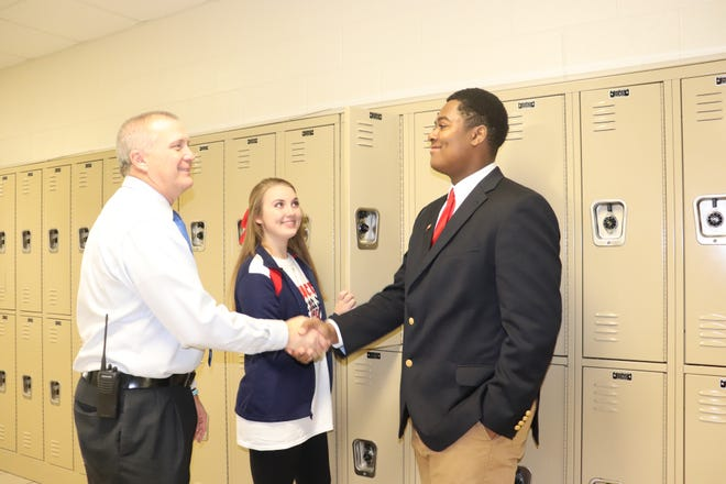 Award-winning Pike Road High School principal David Sikes talks with students. Sikes was recently named principal of the year from among 60 peers.