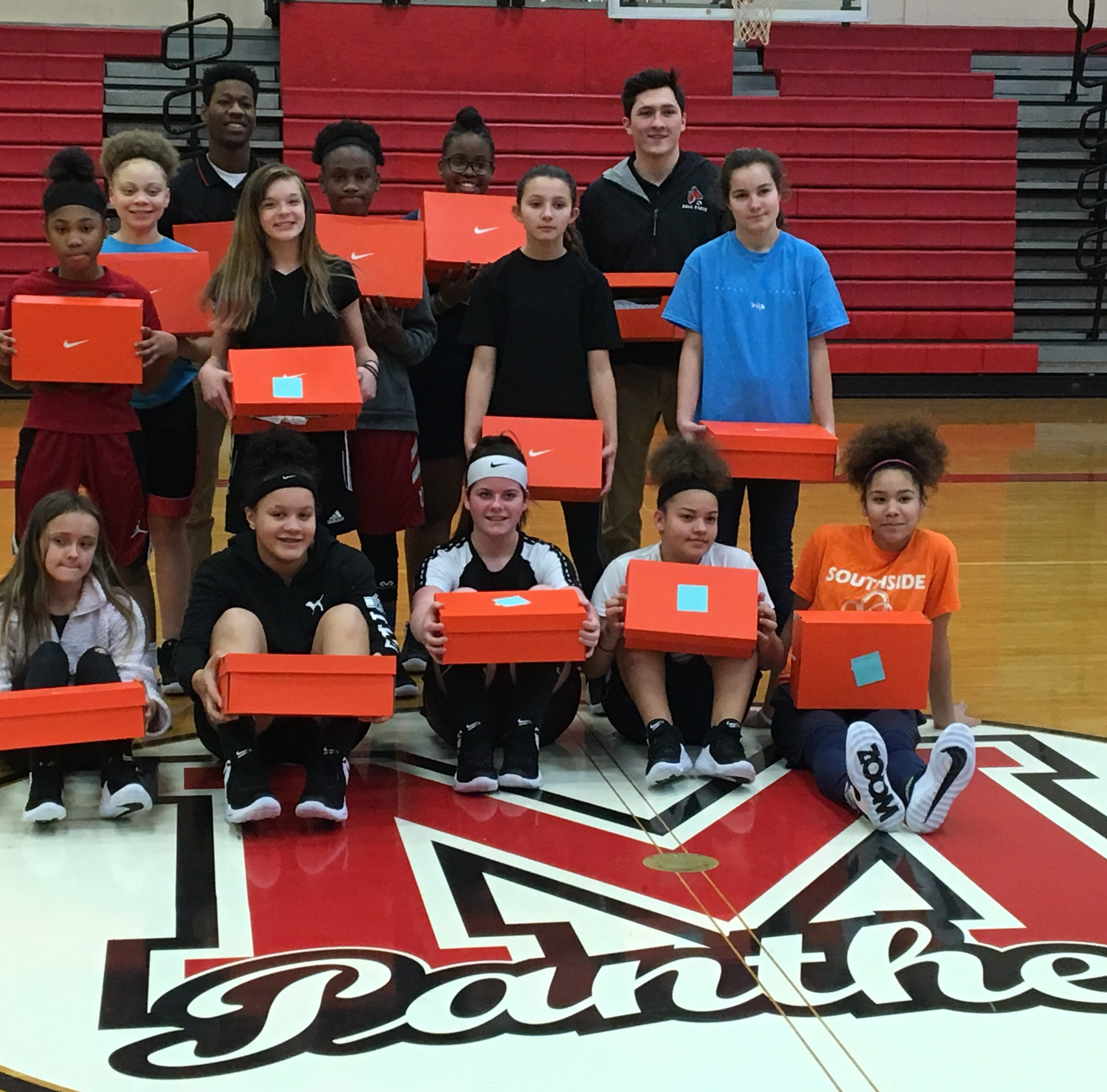Ball State group surprises Southside girls basketball teams with new shoes
