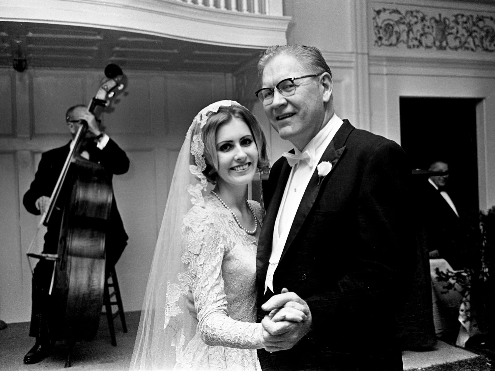 Dr. Thomas Fearn Frist, right, has the first dance with his daughter, the former Mary Louise Frist, to the music of Red Murf and his trio after her marriage to Henry Lee Barfield II during the reception at Belle Meade Country Club on Jan. 31, 1968.